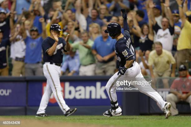 Jonathan Lucroy of the Milwaukee Brewers runs the bases after hitting a solo walkoff home run in the bottom of the ninth inning against the...