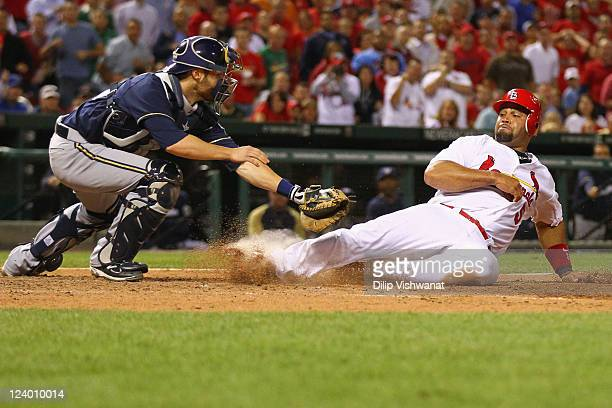 Jonathan Lucroy of the Milwaukee Brewers tags out Albert Pujols of the St Louis Cardinals at Busch Stadium on September 7 2011 in St Louis Missouri...