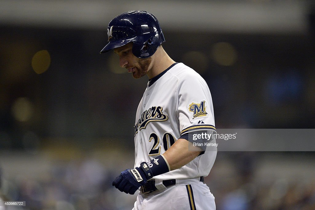 Jonathan Lucroy #20 of the Milwaukee Brewers walks off the field after lining out during the ninth inning against the Pittsburgh Pirates at Miller Park on August 22, 2014 in Milwaukee, Wisconsin. The Pirates defeated the Brewers 8-3.