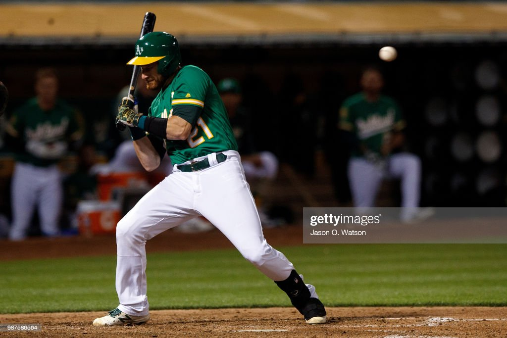 Jonathan Lucroy #21 of the Oakland Athletics avoids an inside pitch against the Cleveland Indians during the seventh inning at the Oakland Coliseum on June 29, 2018 in Oakland, California. The Oakland Athletics defeated the Cleveland Indians 3-1.