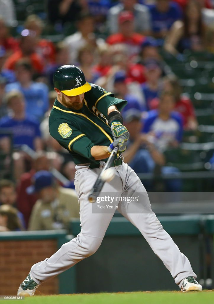 Jonathan Lucroy #21 of the Oakland Athletics hits in the seventh inning against the Texas Rangers at Globe Life Park in Arlington on April 24, 2018 in Arlington, Texas.