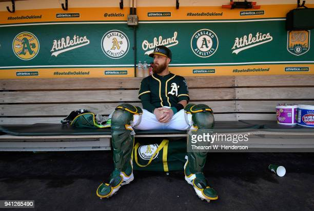 Jonathan Lucroy of the Oakland Athletics sitting in the dugout prepares for his game against the Los Angeles Angels of Anaheim at Oakland Alameda...