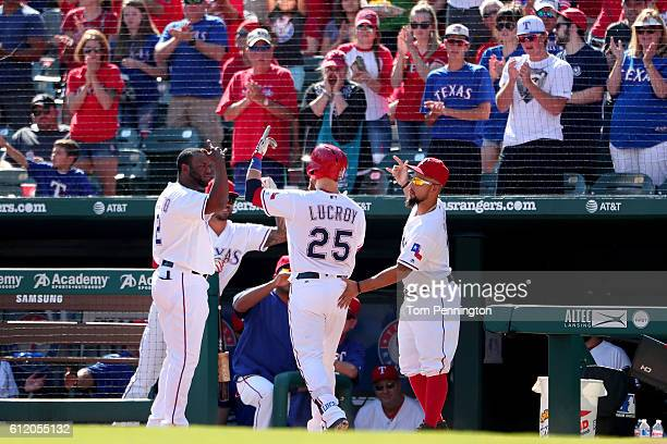 Jonathan Lucroy of the Texas Rangers celebrates with Hanser Alberto of the Texas Rangers and Rougned Odor of the Texas Rangers after hitting a solo...