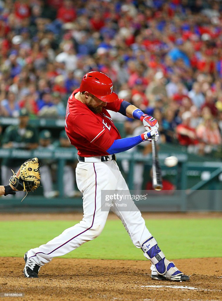 Jonathan Lucroy #25 of the Texas Rangers hits a two run standup double in the seventh inning against the Oakland Athletics at Globe Life Park in Arlington on August 17, 2016 in Arlington, Texas.