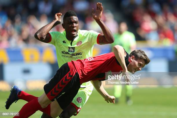 Jonathan Lukas Kuebler of Freiburg fights for the ball with John Cordoba of Mainz during the Bundesliga match between SC Freiburg and 1 FSV Mainz 05...