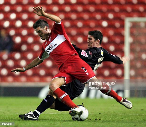 Jonathan Macken of Crystal Palace tackles Franck Quedrue of Middlesbrough during the Carling Cup Fourth Round match between Middlesbrough and Crystal...