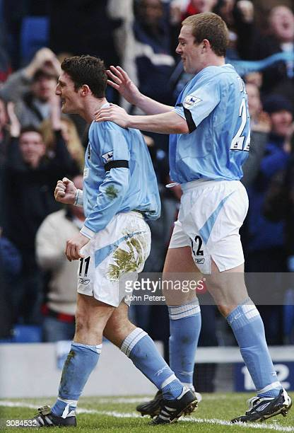 Jonathan Macken of Manchester City celebrates with Richard Dunne after scoring their second goal during the FA Barclaycard Premiership match between...