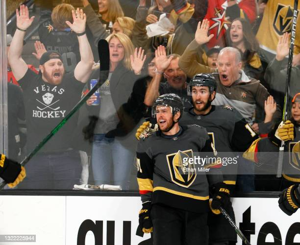 Jonathan Marchessault and Nicolas Roy of the Vegas Golden Knights celebrate Marchessault's second-period power-play goal against the Colorado...