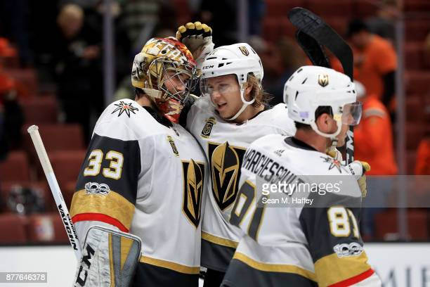 Jonathan Marchessault and William Karlsson congratulate Maxime Lagace of the Vegas Golden Knights after defeating the Anaheim Ducks 42 in a game at...