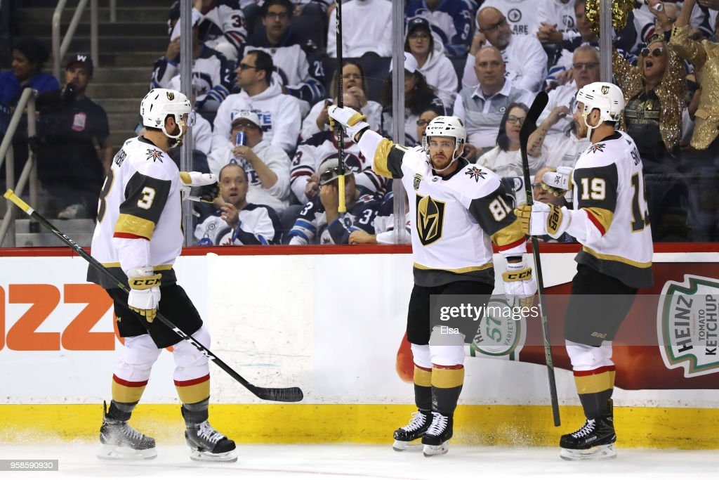 Jonathan Marchessault #81 is congratulated by his teammates Brayden McNabb #3 and Reilly Smith #19 of the Vegas Golden Knights after scoring a first period goal against the Winnipeg Jets in Game Two of the Western Conference Finals during the 2018 NHL Stanley Cup Playoffs at Bell MTS Place on May 14, 2018 in Winnipeg, Canada.