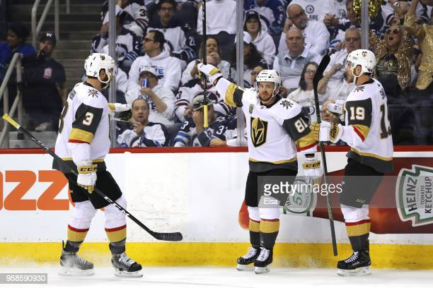 Jonathan Marchessault is congratulated by his teammates Brayden McNabb and Reilly Smith of the Vegas Golden Knights after scoring a first period goal...