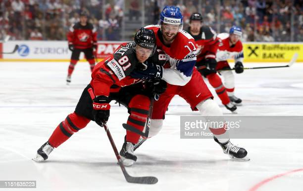 Jonathan Marchessault of Canada challenges Michal Moravcik of Czech Republic during the 2019 IIHF Ice Hockey World Championship Slovakia semi final...