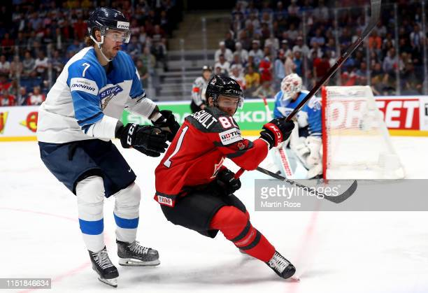 Jonathan Marchessault of Canada challenges Mikko Lehtonen of Finland during the 2019 IIHF Ice Hockey World Championship Slovakia final game between...