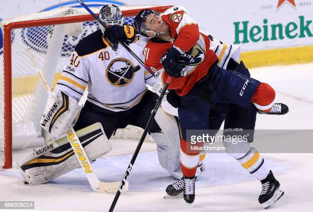 Jonathan Marchessault of the Florida Panthers collides with Dmitry Kulikov of the Buffalo Sabres during a game at BBT Center on April 8 2017 in...