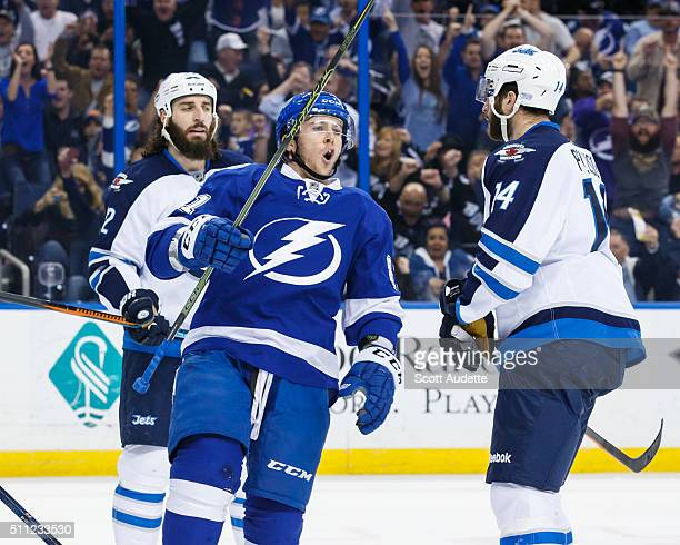 Jonathan Marchessault of the Tampa Bay Lightning celebrates his goal against Chris Thorburn and Anthony Peluso of the Winnipeg Jets during the first...