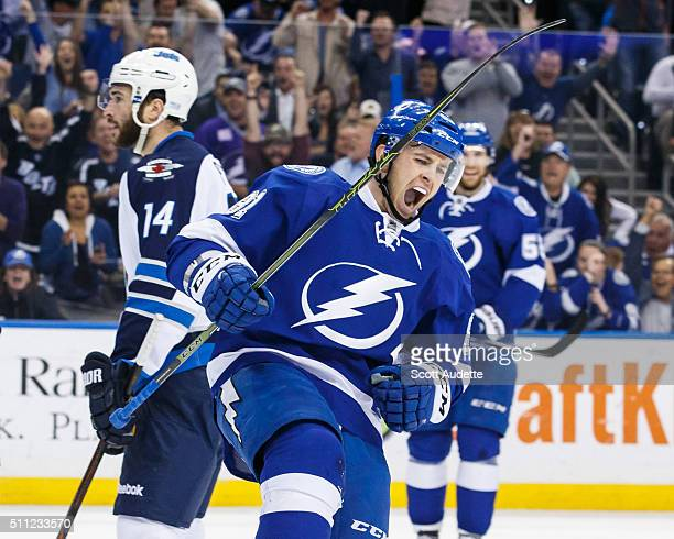 Jonathan Marchessault of the Tampa Bay Lightning celebrates his goal against Anthony Peluso and the Winnipeg Jets during the first period at the...