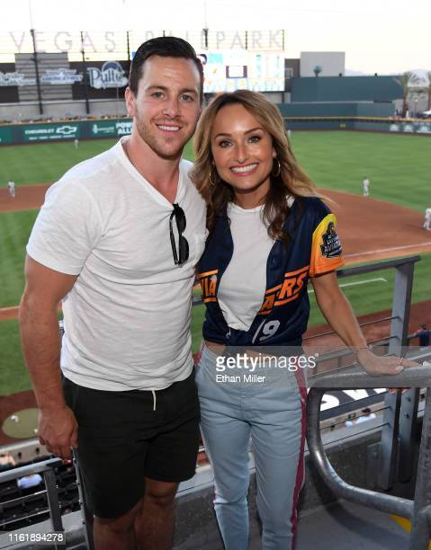 Jonathan Marchessault of the Vegas Golden Knights and chef Giada De Laurentiis pose in the stands during her celebrity chef appearance at Las Vegas...