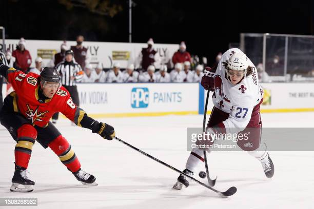 Jonathan Marchessault of the Vegas Golden Knights attempts to block a shot by Ryan Graves of the Colorado Avalanche during the third period during...
