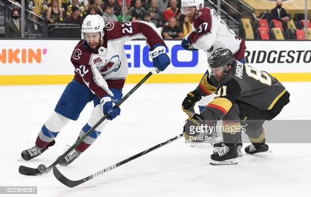 Jonathan Marchessault of the Vegas Golden Knights battles Conor Timmins of the Colorado Avalanche during the first period in Game Six of the Second...
