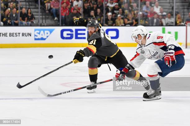 Jonathan Marchessault of the Vegas Golden Knights battles Dmitry Orlov of the Washington Capitals for the puck during the third period in Game Five...