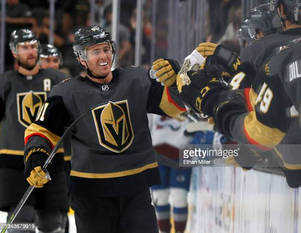 Jonathan Marchessault of the Vegas Golden Knights celebrates with teammates on the bench after scoring a third-period power-play goal against the...
