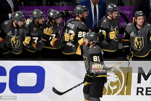 Jonathan Marchessault of the Vegas Golden Knights celebrates with teammates on the bench after assisting Nate Schmidt on a secondperiod goal against...