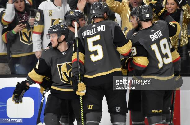 Jonathan Marchessault of the Vegas Golden Knights celebrates with teammates after scoring a goal during the third period against the Winnipeg Jets at...