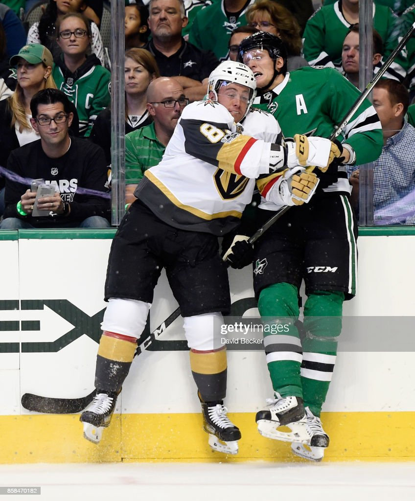 Jonathan Marchessault #81 of the Vegas Golden Knights checks John Klingberg #3 of the Dallas Stars during the season opening game at American Airlines Center on October 6, 2017 in Dallas, Texas.