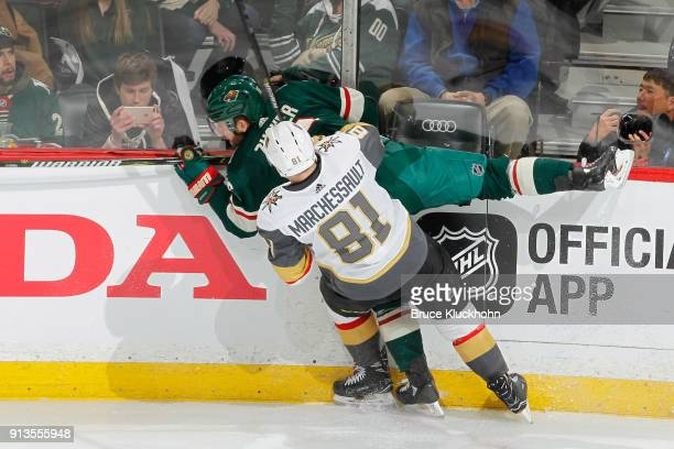 Jonathan Marchessault of the Vegas Golden Knights collides with Jason Zucker of the Minnesota Wild during the game at the Xcel Energy Center on...