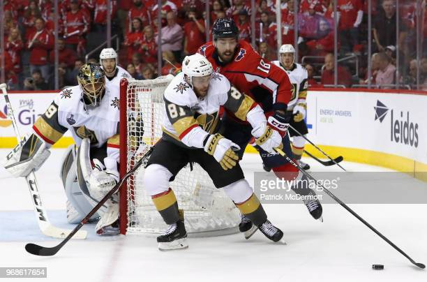 Jonathan Marchessault of the Vegas Golden Knights competes for the puck against Chandler Stephenson of the Washington Capitals during Game Four of...