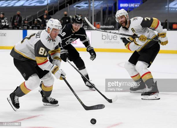 Jonathan Marchessault of the Vegas Golden Knights controls the puck in front of Adrian Kempe of the Los Angeles Kings and Alex Pietrangelo during the...