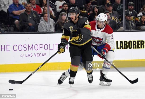 Jonathan Marchessault of the Vegas Golden Knights controls the puck under pressure from Nikita Scherbak of the Montreal Canadiens in the third period...