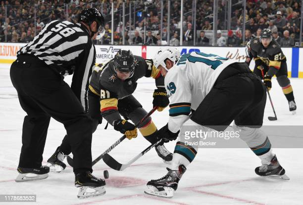 Jonathan Marchessault of the Vegas Golden Knights faces off with Joe Thornton of the San Jose Sharks during the first period at TMobile Arena on...