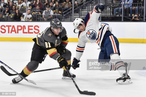 Jonathan Marchessault of the Vegas Golden Knights handles the puck with Brandon Davidson of the Edmonton Oilers defending during the game at TMobile...