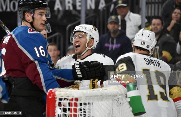Jonathan Marchessault of the Vegas Golden Knights has words with Nikita Zadorov of the Colorado Avalanche during the first period at T-Mobile Arena...