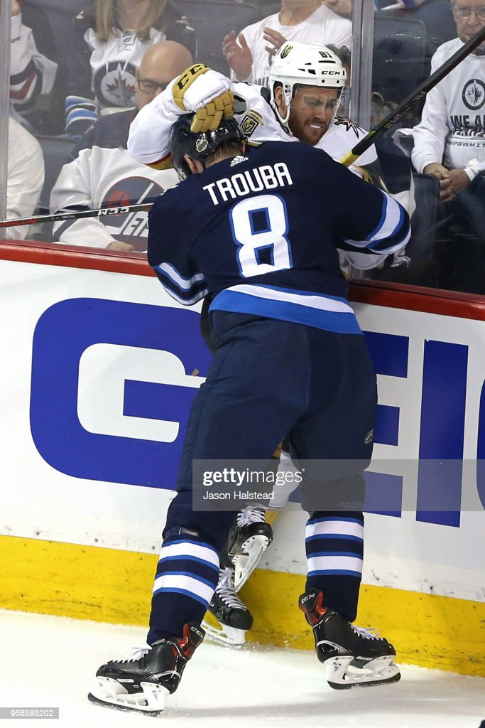 Jonathan Marchessault #81 of the Vegas Golden Knights is checked into the boards by Jacob Trouba #8 of the Winnipeg Jets during the first period in Game Two of the Western Conference Finals during the 2018 NHL Stanley Cup Playoffs at Bell MTS Place on May 14, 2018 in Winnipeg, Canada.