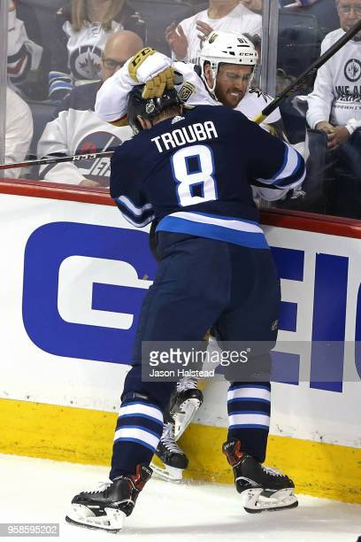 Jonathan Marchessault of the Vegas Golden Knights is checked into the boards by Jacob Trouba of the Winnipeg Jets during the first period in Game Two...