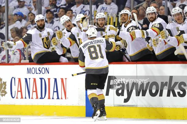 Jonathan Marchessault of the Vegas Golden Knights is congratulated by his teammates after scoring a first period goal against the Winnipeg Jets in...