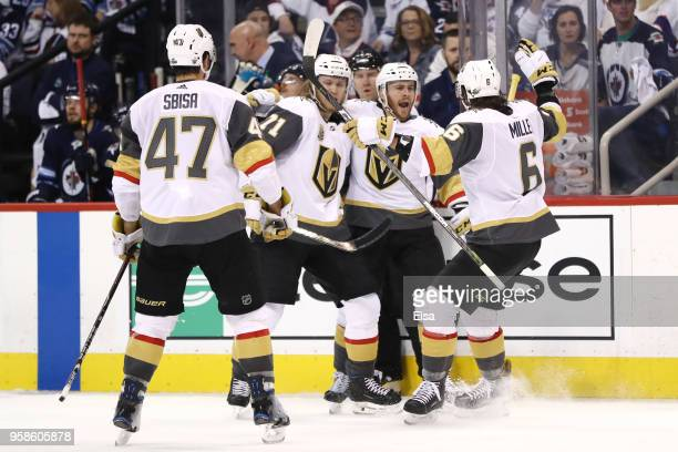 Jonathan Marchessault of the Vegas Golden Knights is congratulated by his teammates after scoring a third period goal against the Winnipeg Jets in...