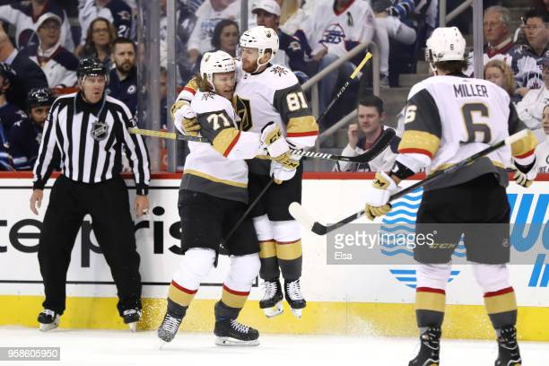 Jonathan Marchessault of the Vegas Golden Knights is congratulated by his teammate William Karlsson after scoring a third period goal against the...