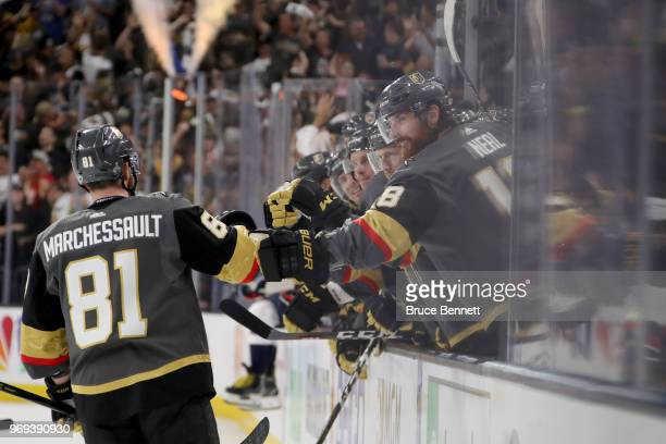 Jonathan Marchessault of the Vegas Golden Knights is congratulated by his teammates at the bench after scoring a secondperiod goal against the...