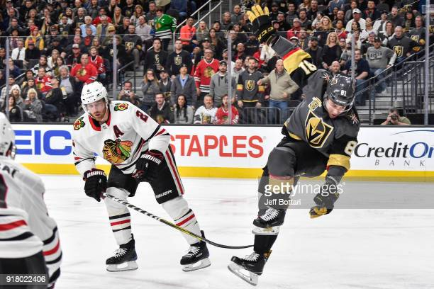 Jonathan Marchessault of the Vegas Golden Knights loses his balance after colliding with Duncan Keith of the Chicago Blackhawks at TMobile Arena on...