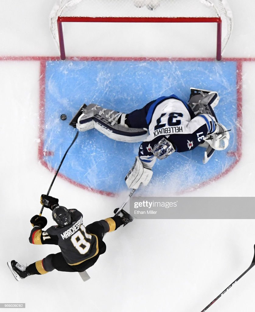 Jonathan Marchessault #81 of the Vegas Golden Knights scores a first-period goal against Connor Hellebuyck #37 of the Winnipeg Jets in Game Three of the Western Conference Finals during the 2018 NHL Stanley Cup Playoffs at T-Mobile Arena on May 16, 2018 in Las Vegas, Nevada.