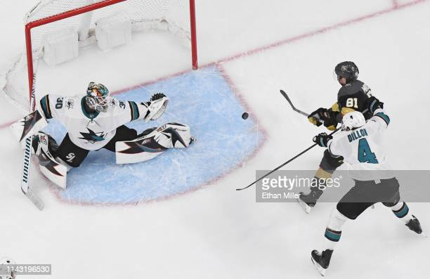 Jonathan Marchessault of the Vegas Golden Knights scores a thirdperiod powerplay goal against Aaron Dell of the San Jose Sharks as Brenden Dillon of...