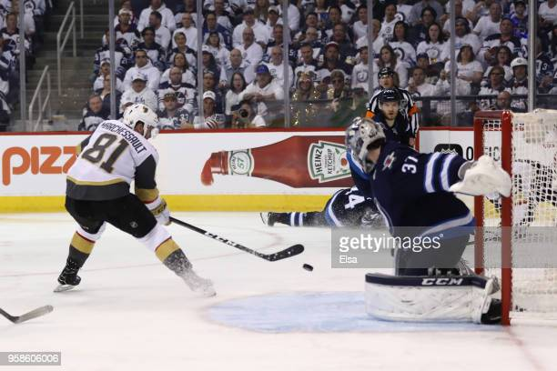 Jonathan Marchessault of the Vegas Golden Knights scores a third period goal past Connor Hellebuyck of the Winnipeg Jets during the third period in...