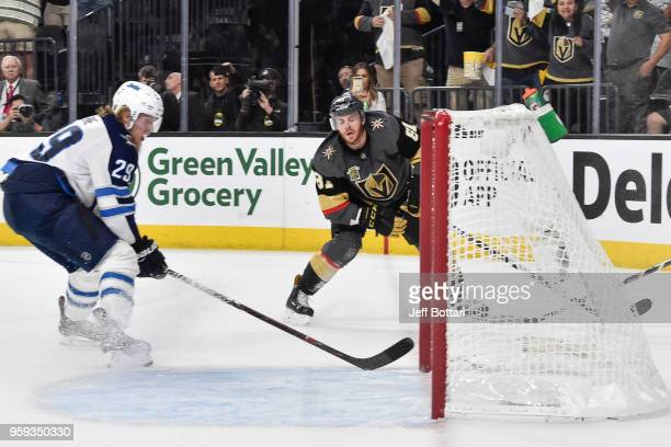 Jonathan Marchessault of the Vegas Golden Knights scores an emptynet goal against Patrik Laine of the Winnipeg Jets in Game Three of the Western...