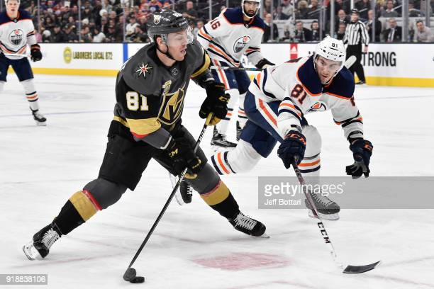 Jonathan Marchessault of the Vegas Golden Knights shoots the puck with Yohann Auvitu of the Edmonton Oilers defending during the game at TMobile...