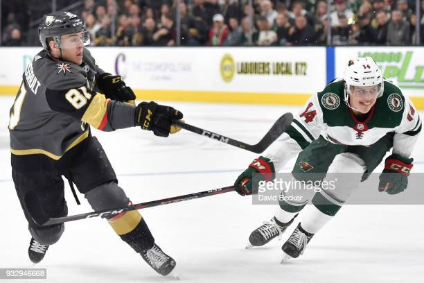Jonathan Marchessault of the Vegas Golden Knights shoots the puck with Joel Eriksson Ek of the Minnesota Wild defending during the game at TMobile...