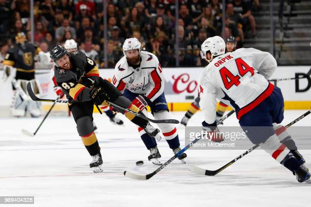 Jonathan Marchessault of the Vegas Golden Knights shoots the puck into the Washington Capitals zone past Brooks Orpik of the Washington Capitals in...
