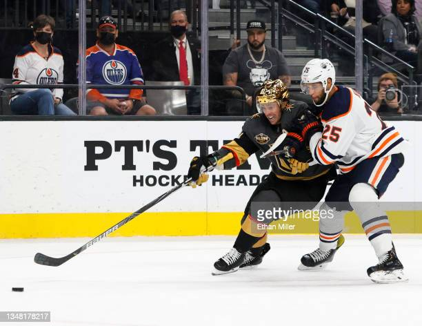 Jonathan Marchessault of the Vegas Golden Knights skates with the puck under pressure from Darnell Nurse of the Edmonton Oilers in the second period...
